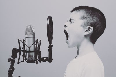 boy-shouting-on-microphone