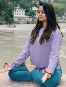 Yogini-perfroming-meditation-river-bank