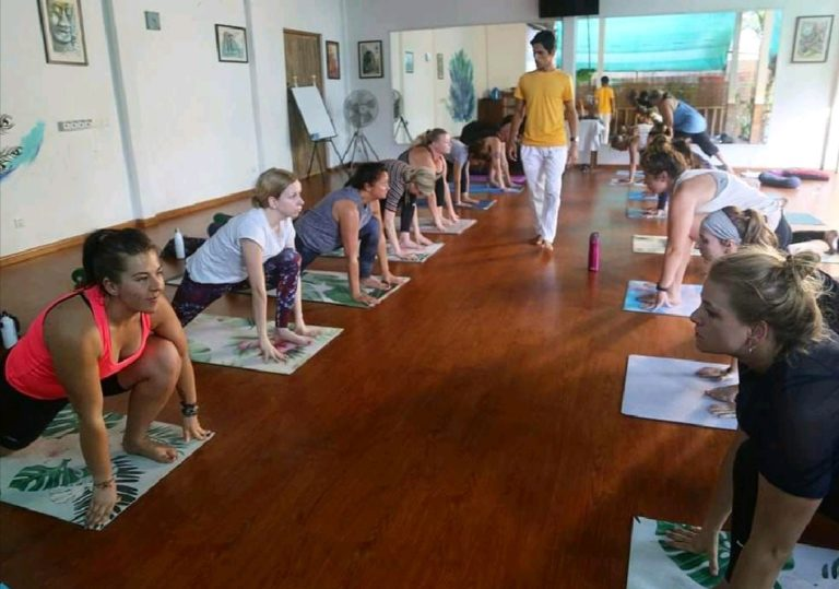 yoga-instructor-teaching-yoga