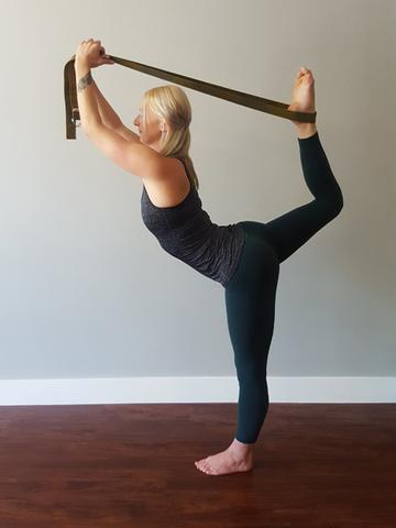 Girl-stretching-her-legs-with-yoga-straps