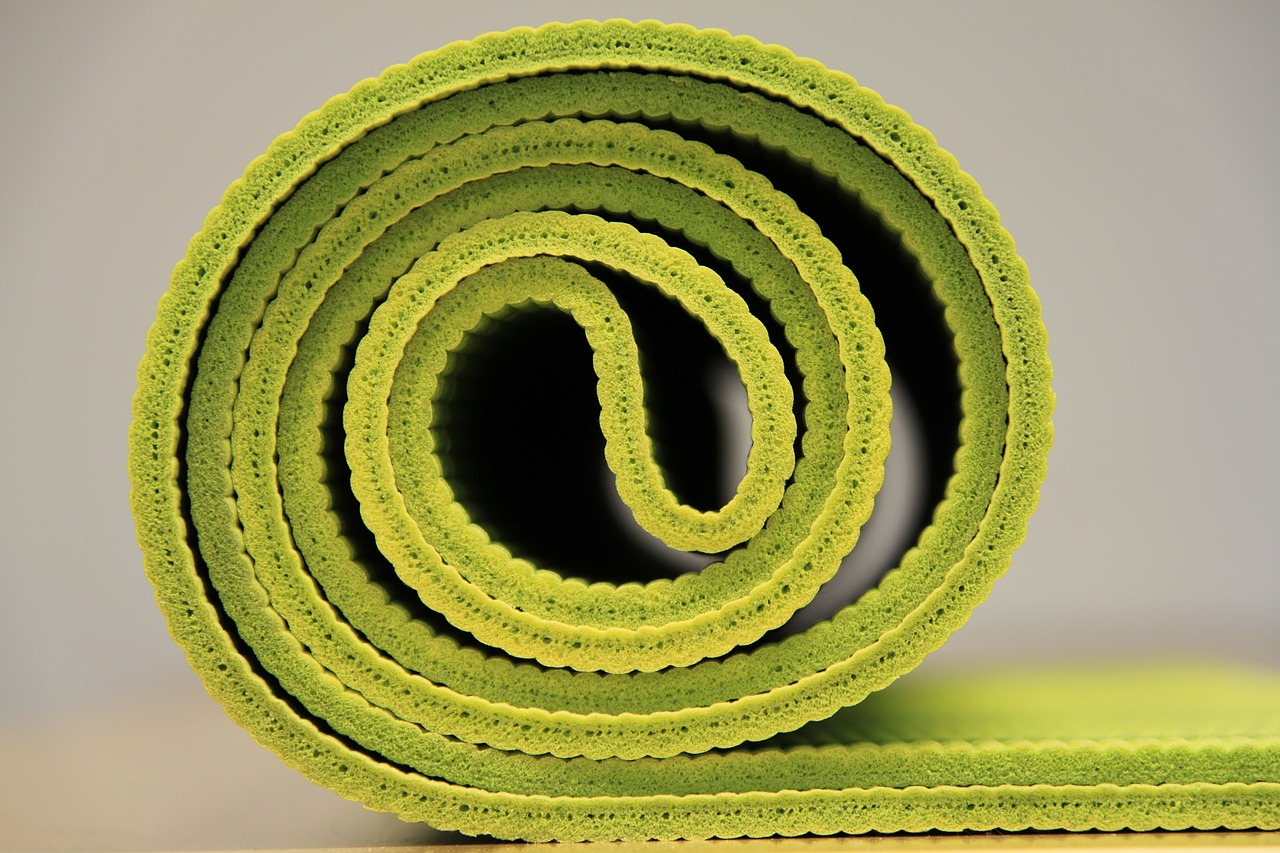 Green-colored-rolled-yoga-mat