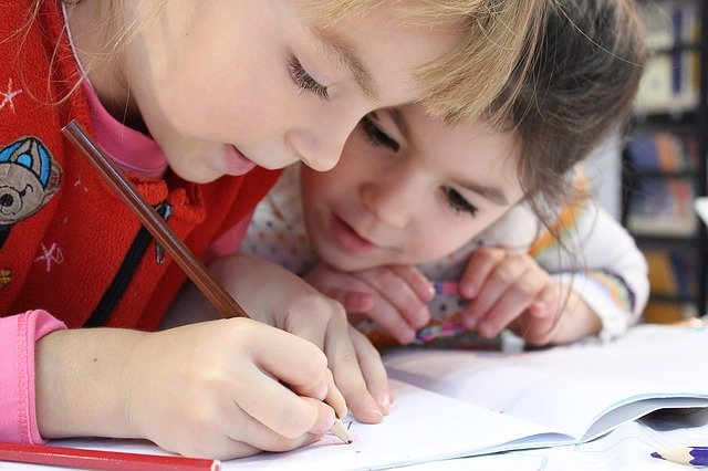 kids-writting-on-paper-with-pencil-self-study