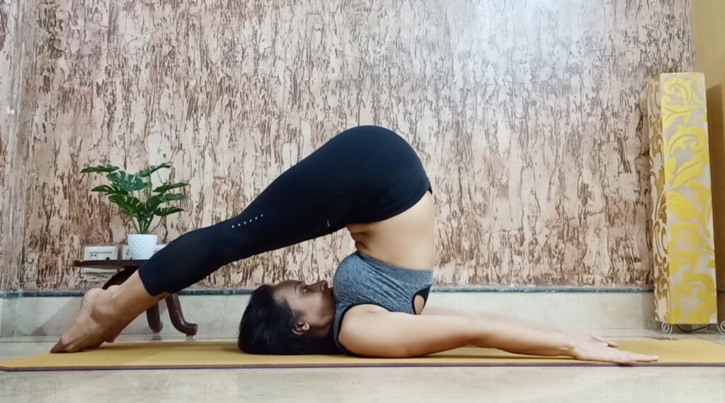 Halasana or plough pose